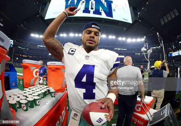 Dak Prescott of the Dallas Cowboys celebrates after the Dallas Cowboys beat the New York Giants 193 at ATT Stadium on September 10 2017 in Arlington...