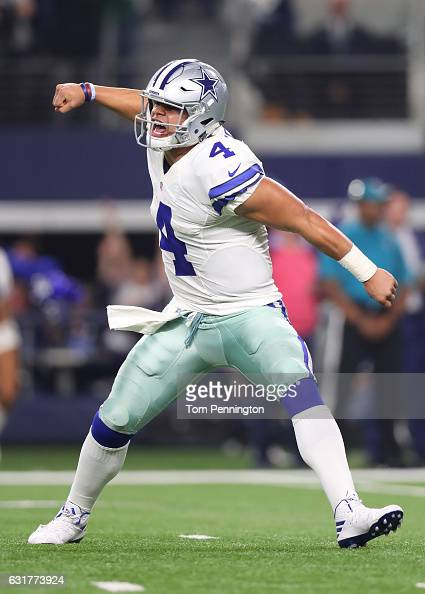 Dak Prescott of the Dallas Cowboys celebrates after throwing a touchdown pass during the fourth quarter against the Green Bay Packers in the NFC...