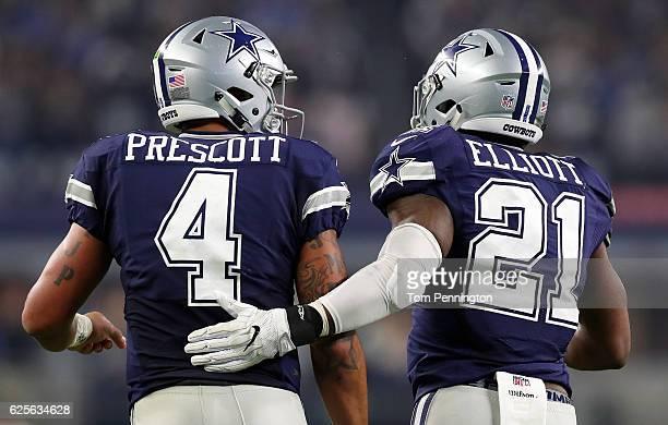 Dak Prescott of the Dallas Cowboys celebrates with Ezekiel Elliott after scoring a touchdown during the fourth quarter against the Washington...
