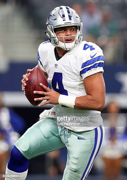 Dak Prescott of the Dallas Cowboys drops back to pass during the first quarter against the Baltimore Ravens at ATT Stadium on November 20 2016 in...