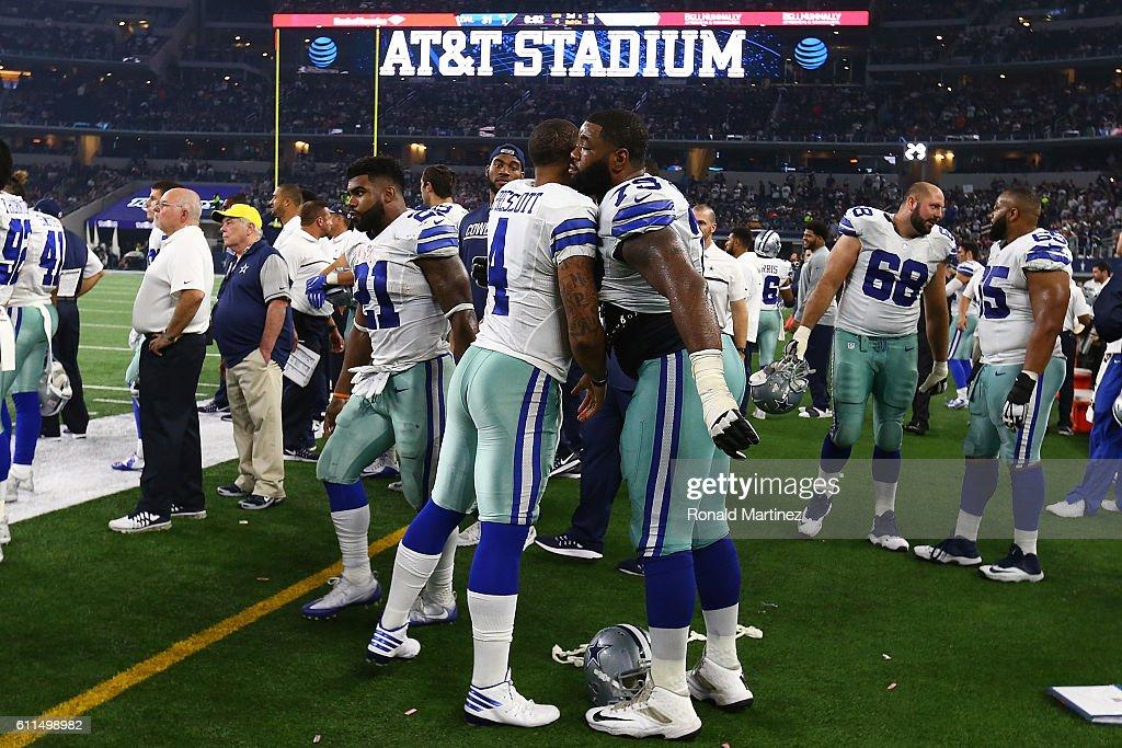 625e29a03 ... Dak Prescott 4 of the Dallas Cowboys hugs Chaz Green 79 at ATT Stadium  ...