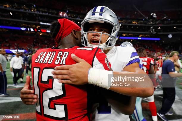 Dak Prescott of the Dallas Cowboys hugs Mohamed Sanu of the Atlanta Falcons after the game at MercedesBenz Stadium on November 12 2017 in Atlanta...