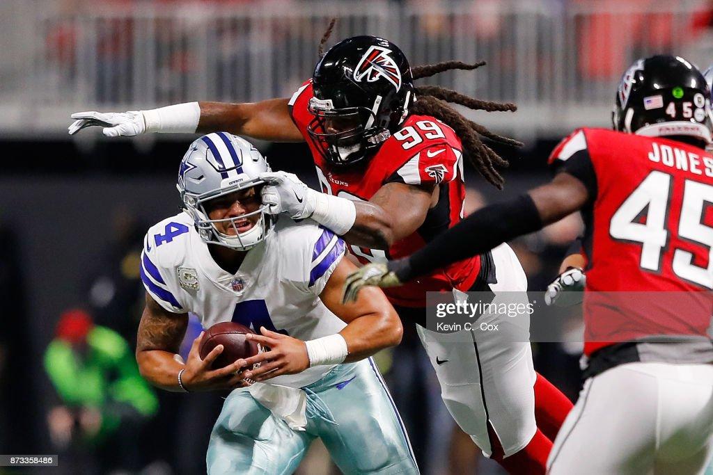 Dak Prescott #4 of the Dallas Cowboys is sacked by Adrian Clayborn #99 of the Atlanta Falcons during the first half at Mercedes-Benz Stadium on November 12, 2017 in Atlanta, Georgia.