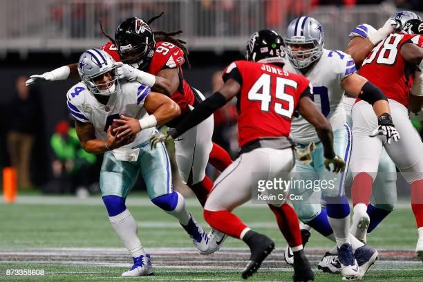 Dak Prescott of the Dallas Cowboys is sacked by Adrian Clayborn of the Atlanta Falcons during the first half at MercedesBenz Stadium on November 12...