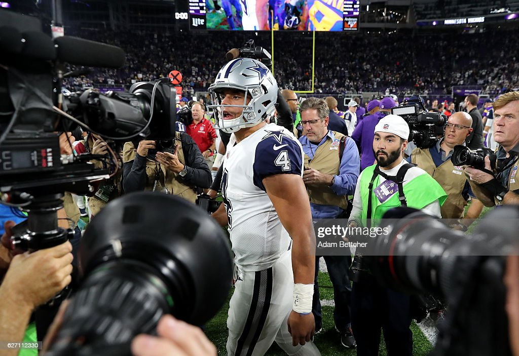Dak Prescott #4 of the Dallas Cowboys is surrounded by cameras after the game against the Minnesota Vikings on December 1, 2016 at US Bank Stadium in Minneapolis, Minnesota. The Cowboys defeated the Vikings 17-15.