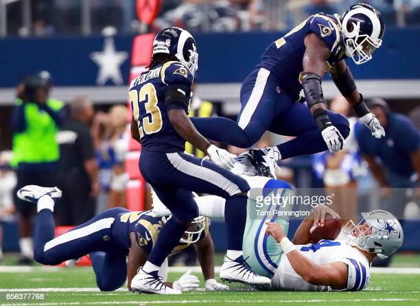 Dak Prescott of the Dallas Cowboys is tackled by Trumaine Johnson of the Los Angeles Rams Nickell RobeyColeman of the Los Angeles Rams and Alec...