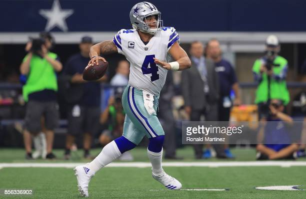 Dak Prescott of the Dallas Cowboys looks to pass against the Los Angeles Rams in the second quarter at ATT Stadium on October 1 2017 in Arlington...