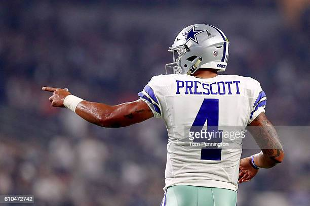 Dak Prescott of the Dallas Cowboys reacts after throwing for a touchdown during a game between the Dallas Cowboys and the Chicago Bears at ATT...
