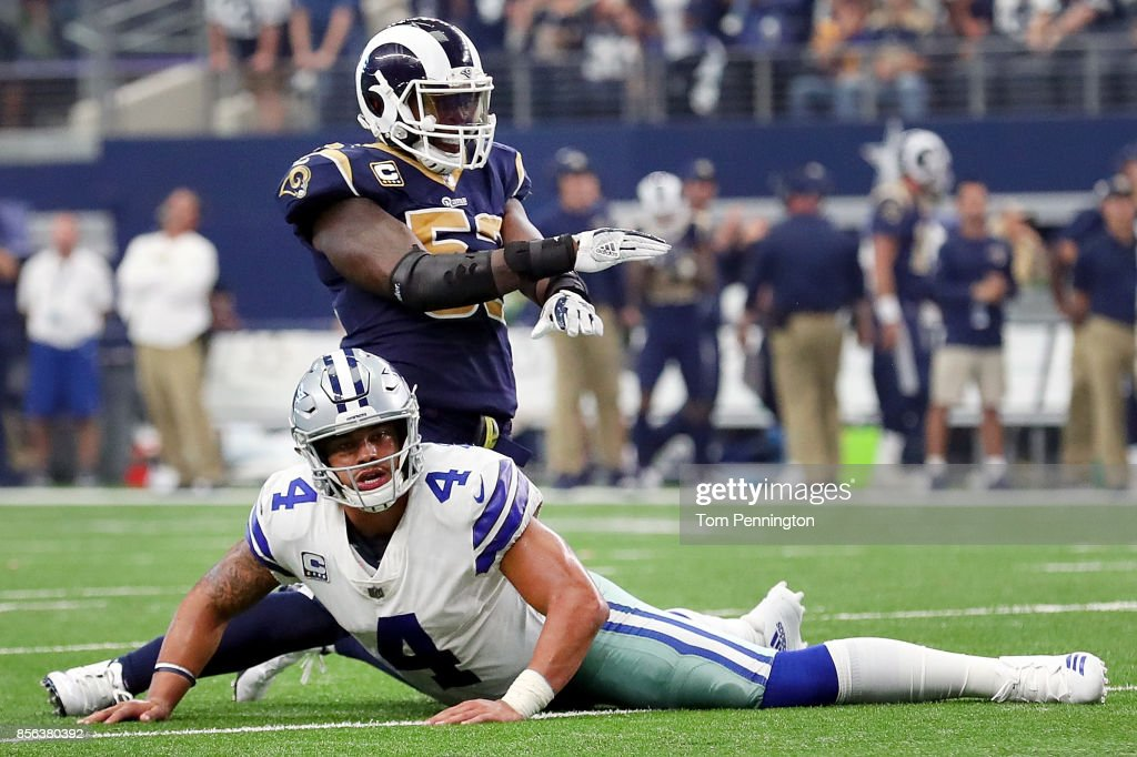 Dak Prescott #4 of the Dallas Cowboys reacts as Alec Ogletree #52 of the Los Angeles Rams celebrates after the the Dallas Cowboys failed to score on a two point conversion in the fourth quarter at AT&T Stadium on October 1, 2017 in Arlington, Texas.