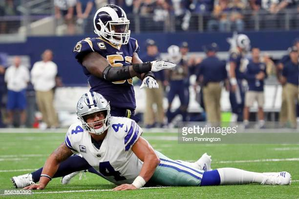 Dak Prescott of the Dallas Cowboys reacts as Alec Ogletree of the Los Angeles Rams celebrates after the the Dallas Cowboys failed to score on a two...