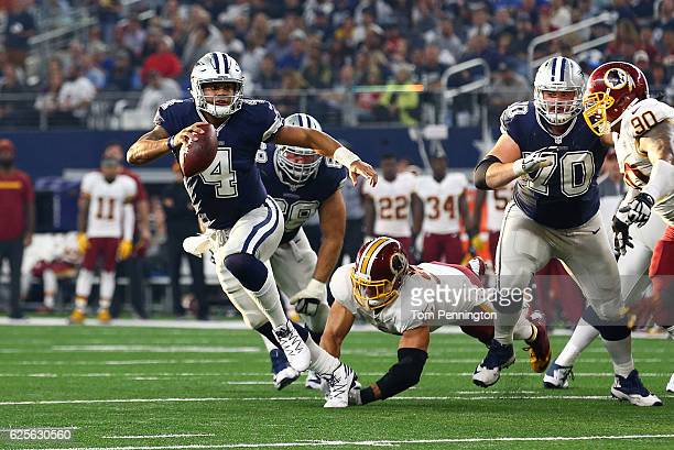 Dak Prescott of the Dallas Cowboys rolls out to pass during the second quarter against the Washington Redskins at ATT Stadium on November 24 2016 in...