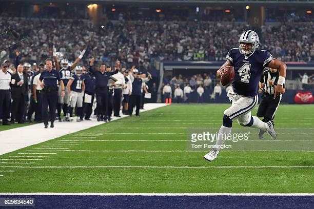 Dak Prescott of the Dallas Cowboys rushes for a touchdown during the fourth quarter against the Washington Redskins at ATT Stadium on November 24...