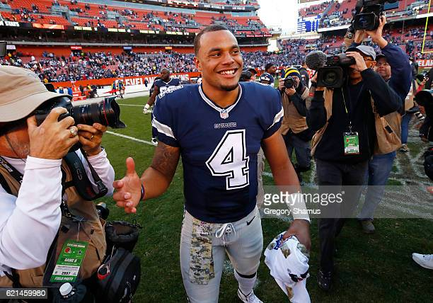 Dak Prescott of the Dallas Cowboys smiles after defeating the Cleveland Browns 3510 at FirstEnergy Stadium on November 6 2016 in Cleveland Ohio
