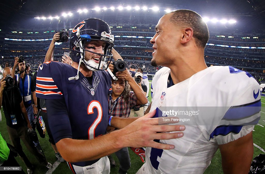 Dak Prescott #4 of the Dallas Cowboys talks with Brian Hoyer #2 of the Chicago Bears after the Cowboys beat the Bears 31-17 at AT&T Stadium on September 25, 2016 in Arlington, Texas.