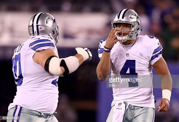 Dak Prescott of the Dallas Cowboys talks with Zack Martin against the New York Giants during the first half of the game at MetLife Stadium on...