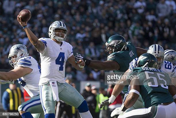 Dak Prescott of the Dallas Cowboys throws a pass in the first quarter against Fletcher Cox of the Philadelphia Eagles at Lincoln Financial Field on...