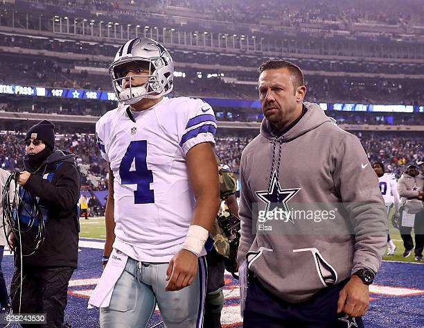 Dak Prescott of the Dallas Cowboys walks off the field after the loss to the New York Giants at MetLife Stadium on December 11 2016 in East...
