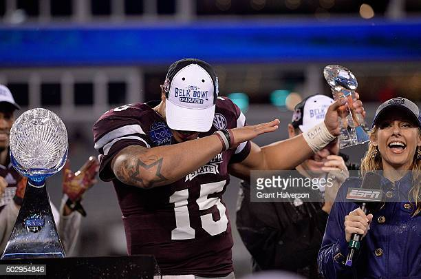 Dak Prescott of the Mississippi State Bulldogs does the Dab to celebrate a win against the North Carolina State Wolfpack in the Belk Bowl at Bank of...