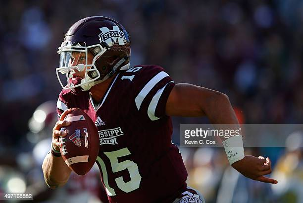 Dak Prescott of the Mississippi State Bulldogs rushes out of the pocket against the Alabama Crimson Tide at Davis Wade Stadium on November 14 2015 in...