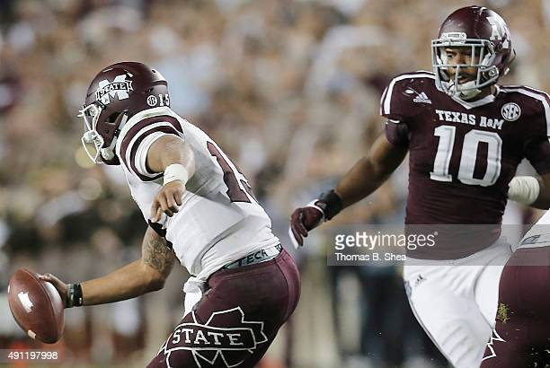 Dak Prescott of the Mississippi State Bulldogs scrambles from Daeshon Hall of the Texas AM Aggies in the second half on October 3 2015 at Kyle Field...