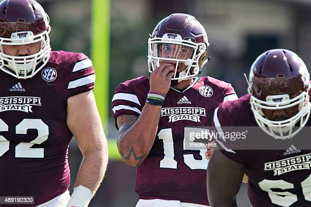 Dak Prescott of the Mississippi State Bulldogs walks to the line of scrimmage during a game against the Northwestern State Demons at Davis Wade...
