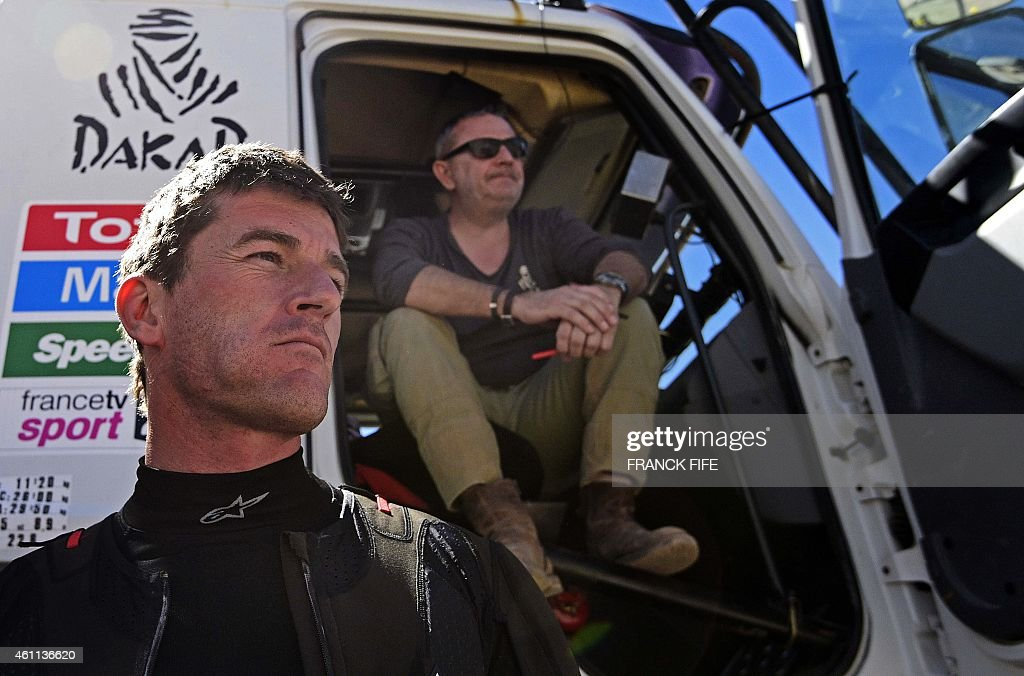 Dakar Rally director <a gi-track='captionPersonalityLinkClicked' href=/galleries/search?phrase=Etienne+Lavigne&family=editorial&specificpeople=643127 ng-click='$event.stopPropagation()'>Etienne Lavigne</a> (R) and KTM's Spanish biker <a gi-track='captionPersonalityLinkClicked' href=/galleries/search?phrase=Marc+Coma&family=editorial&specificpeople=767761 ng-click='$event.stopPropagation()'>Marc Coma</a> gesture before the start of the Stage 4 of the Dakar 2015 between Chilecito, in Argentina and Copiapo, Chile, on January 7, 2015.