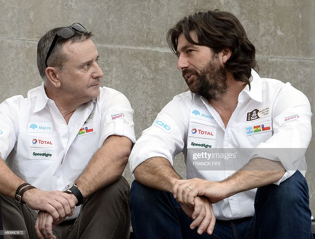 Dakar Rally director <a gi-track='captionPersonalityLinkClicked' href=/galleries/search?phrase=Etienne+Lavigne&family=editorial&specificpeople=643127 ng-click='$event.stopPropagation()'>Etienne Lavigne</a> (L) and sport director, French David Castera, chat in Buenos Aires on January 3, 2015 hours before the symbolic start of the competition in the Argentine capital today, before participants race across Argentina, Chile and Bolivia in a two-week test of endurance.