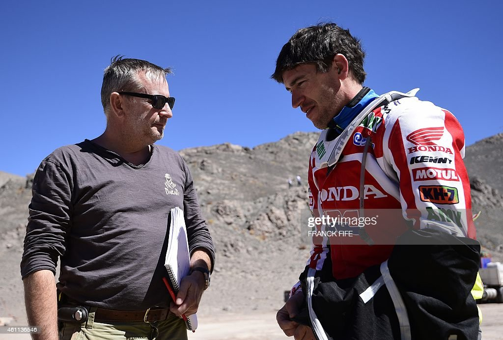 Dakar Rally director <a gi-track='captionPersonalityLinkClicked' href=/galleries/search?phrase=Etienne+Lavigne&family=editorial&specificpeople=643127 ng-click='$event.stopPropagation()'>Etienne Lavigne</a> (L) speaks with Honda's Spanish biker Joan Barreda Bort, before the start of the Stage 4 of the Dakar 2015 between Chilecito, in Argentina and Copiapo, Chile, on January 7, 2015. AFP PHOTO / FRANCK FIFE