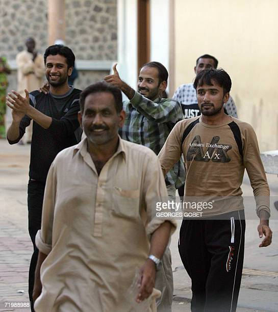 Migrants from India and Pakistan leave a courthouse in Dakar 25 September 2006 after being charged with a 2 year suspended sentence for attempting...