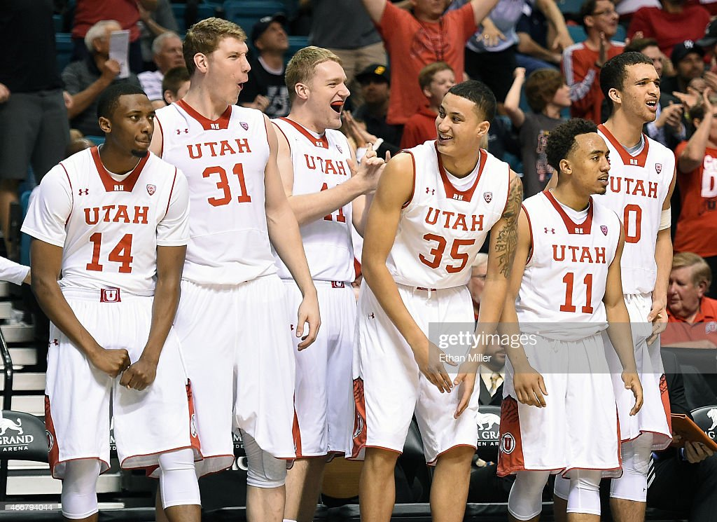 Dakarai Tucker #14, Dallin Bachynski #31, Jeremy Olsen #41, Kyle Kuzma #35, Brandon Taylor #11 and Brekkott Chapman #0 of the Utah Utes celebrate on the bench late in their quarterfinal game of the Pac-12 Basketball Tournament against the Stanford Cardinal at the MGM Grand Garden Arena on March 12, 2015 in Las Vegas, Nevada. Utah won 80-56.
