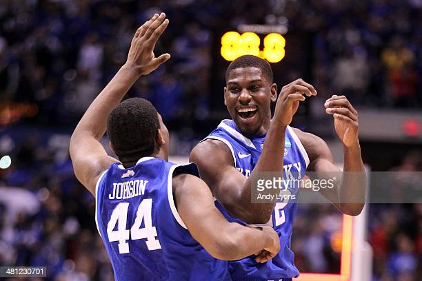 Dakari Johnson and Alex Poythress of the Kentucky Wildcats celebrate defeating the Louisville Cardinals 74 to 69 during the regional semifinal of the...