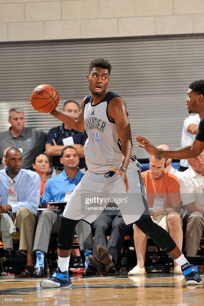 Dakari Johnson of Oklahoma City Thunder handles the ball during the game against the Los Angeles Clippers during the 2016 NBA Orlando Summer League...