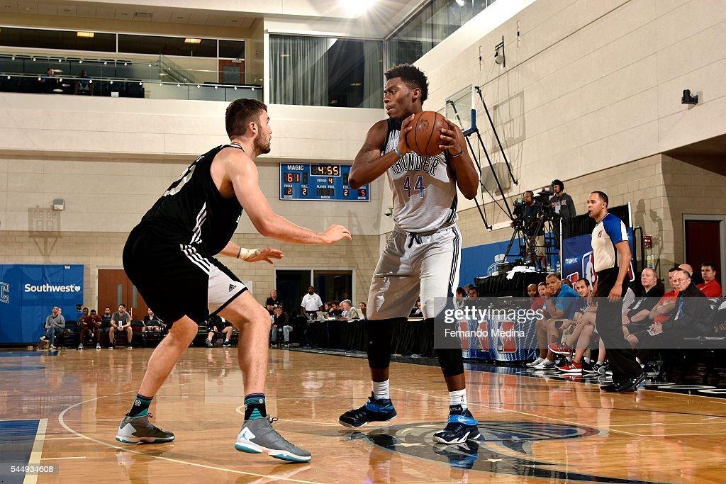 Dakari Johnson of Oklahoma City Thunder handles the ball during the game against the Charlotte Hornets during the 2016 NBA Orlando Summer League on...