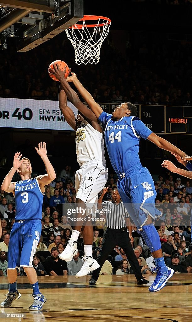 Dakari Johnson #44 of the Kentucky Wildcats and James Siakam #35 of the Vanderbilt Commodores jump for a loose ball at Memorial Gym on January 11, 2014 in Nashville, Tennessee.