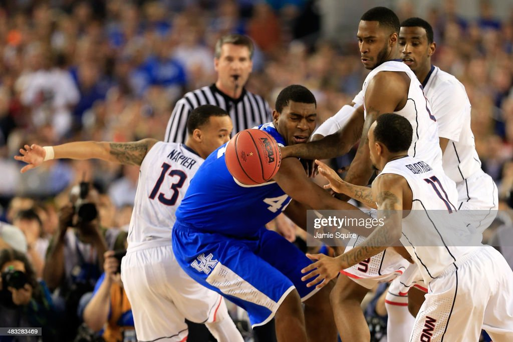 <a gi-track='captionPersonalityLinkClicked' href=/galleries/search?phrase=Dakari+Johnson&family=editorial&specificpeople=10784938 ng-click='$event.stopPropagation()'>Dakari Johnson</a> #44 of the Kentucky Wildcats battles for a loose ball against Phillip Nolan #0 and <a gi-track='captionPersonalityLinkClicked' href=/galleries/search?phrase=Ryan+Boatright&family=editorial&specificpeople=8698049 ng-click='$event.stopPropagation()'>Ryan Boatright</a> #11 of the Connecticut Huskies during the NCAA Men's Final Four Championship at AT&T Stadium on April 7, 2014 in Arlington, Texas.