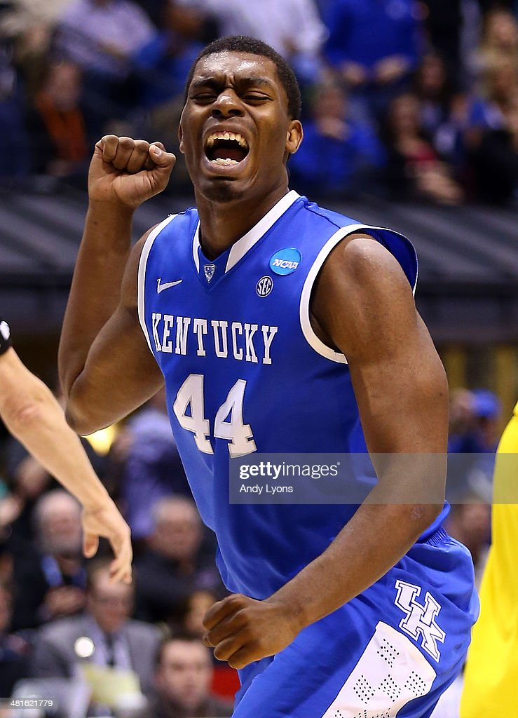 Dakari Johnson of the Kentucky Wildcats celebrates after a two point play and the foul in the second half against the Michigan Wolverines during the...