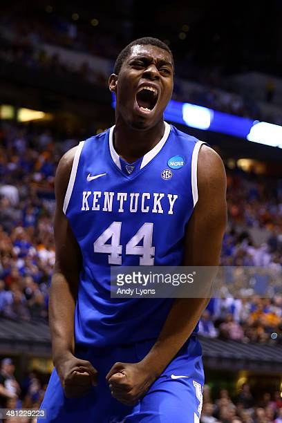 Dakari Johnson of the Kentucky Wildcats celebrates after making a basket in the first half against the Louisville Cardinals during the regional...
