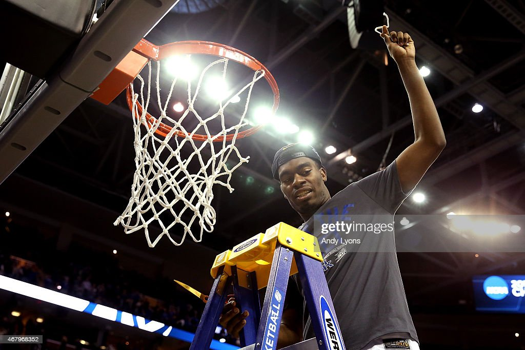 <a gi-track='captionPersonalityLinkClicked' href=/galleries/search?phrase=Dakari+Johnson&family=editorial&specificpeople=10784938 ng-click='$event.stopPropagation()'>Dakari Johnson</a> #44 of the Kentucky Wildcats cuts down the nets after defeating the Notre Dame Fighting Irish during the Midwest Regional Final of the 2015 NCAA Men's Basketball tournament at Quicken Loans Arena on March 28, 2015 in Cleveland, Ohio. Kentucky defeated Notre Dame 68-66.