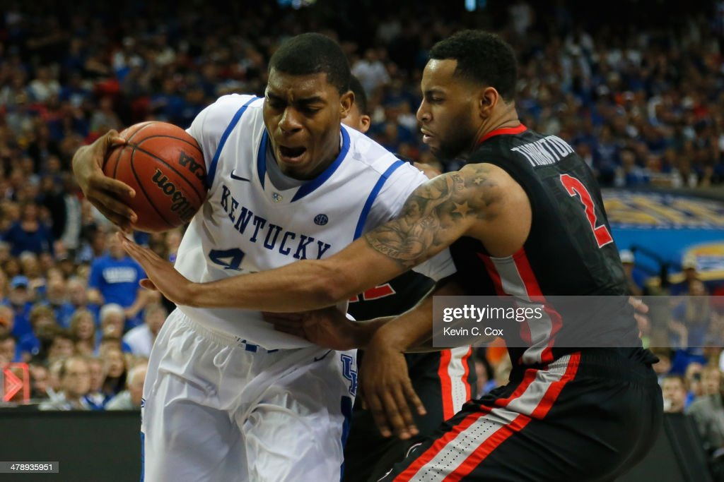 Dakari Johnson #44 of the Kentucky Wildcats drives with the ball against Marcus Thornton #2 of the Georgia Bulldogs during the semifinals of the SEC Men's Basketball Tournament at Georgia Dome on March 15, 2014 in Atlanta, Georgia.