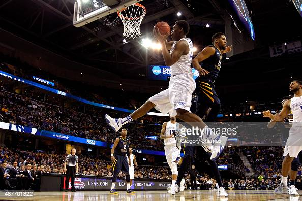 Dakari Johnson of the Kentucky Wildcats goes up with the ball against Gary Browne of the West Virginia Mountaineers in the second half during the...