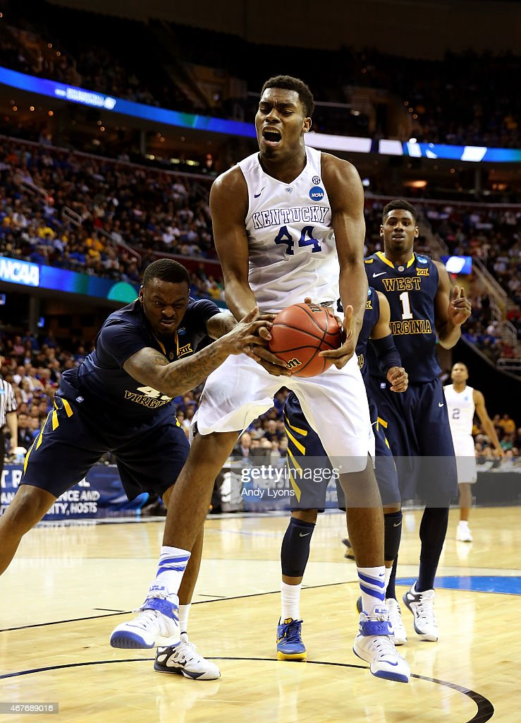 Dakari Johnson of the Kentucky Wildcats handles the ball against Elijah Macon of the West Virginia Mountaineers in the second half during the Midwest...