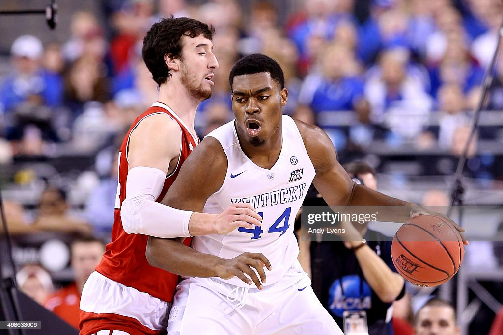 Dakari Johnson of the Kentucky Wildcats handles the ball against Frank Kaminsky of the Wisconsin Badgers in the first half during the NCAA Men's...