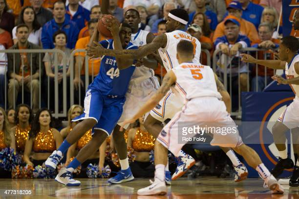 Dakari Johnson of the Kentucky Wildcats is defended by Dorian FinneySmith of the Florida Gators during the first half of the game at the Stephen C...