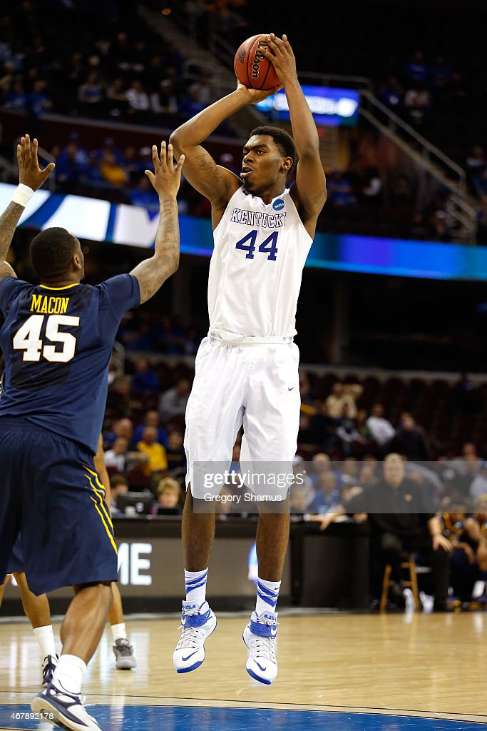 Dakari Johnson of the Kentucky Wildcats shoots against Elijah Macon of the West Virginia Mountaineers during the Midwest Regional semifinal of the...