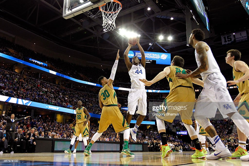 Dakari Johnson of the Kentucky Wildcats shoots against Zach Auguste of the Notre Dame Fighting Irish in the second half during the Midwest Regional...