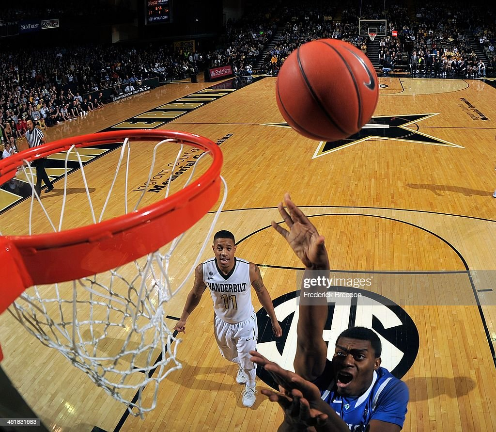 Dakari Johnson #44 of the Kentucky Wildcats takes a shot as Kyle Fuller #11 of the Vanderbilt Commodores watches at Memorial Gym on January 11, 2014 in Nashville, Tennessee.