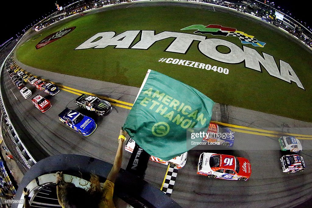 Dakoda Armstrong driver of the Fresh from Florida Ford and Trevor Bayne driver of the AdvoCare Ford lead the field to start the NASCAR Nationwide...