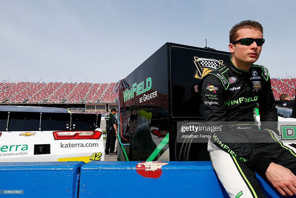 Dakoda Armstrong, driver of the #28 WinField Be Greater Toyota, looks on during qualifying for the NASCAR XFINITY Series Sparks Energy 300 at Talladega Superspeedway on April 30, 2016 in Talladega, Alabama.
