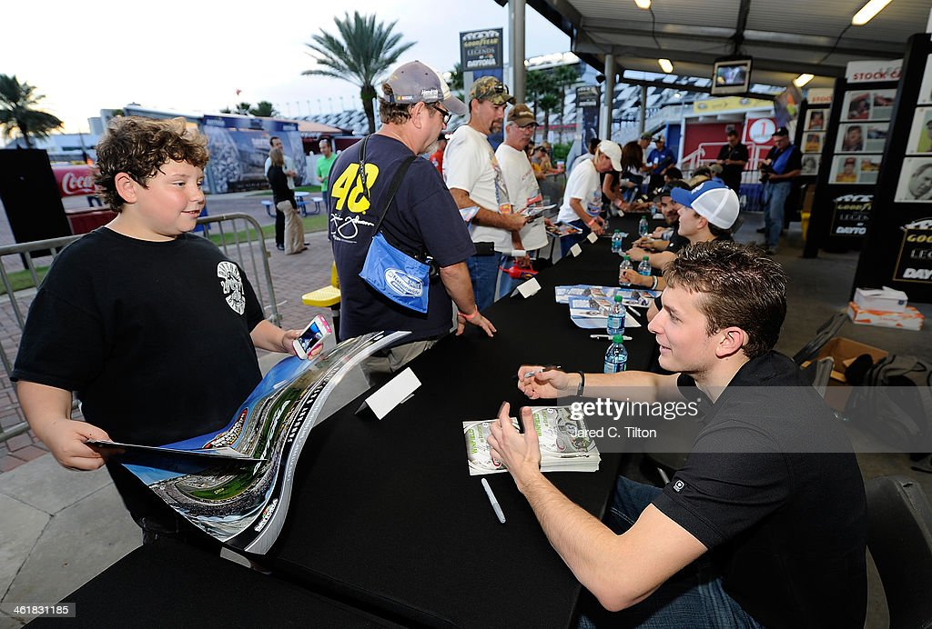 Dakoda Armstrong, driver of the #43 Winfield Ford, signs autographs along with other Nationwide Series drivers during NASCAR Preseason Thunder at Daytona International Speedway on January 11, 2014 in Daytona Beach, Florida.