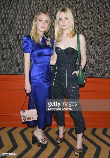 Dakota Fanning and Elle Fanning attend the Miu Miu aftershow party as part of the Paris Fashion Week Womenswear Spring/Summer 2018 at Boum Boum on...